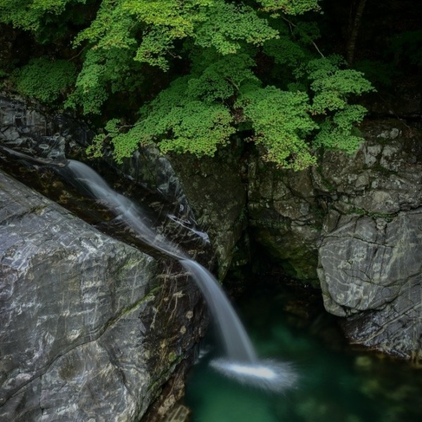 『Waterfall flowing down the rock』